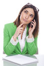 Thoughtful executive secretary on the phone Royalty Free Stock Images