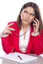 Thoughtful executive secretary at the phone Stock Image