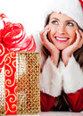 Thoughtful female Santa with presents Stock Image
