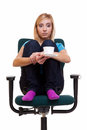 Thoughtful girl on chair holds cup tea or coffee sad worried female college student sitting relaxing a of isolated white Royalty Free Stock Photo