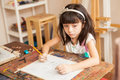Thoughtful girl drawing for art class Royalty Free Stock Photo