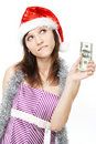 Thoughtful girl with money Stock Images