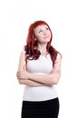 Thoughtful girl pensive redhead on white background Stock Image
