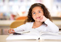 Thoughtful girl reading a book Royalty Free Stock Photography