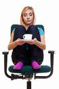 Thoughtful girl relaxing in chair holds a cup of tea or coffee sad worried female college student sitting on isolated on white Royalty Free Stock Photos