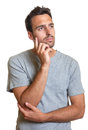 Thoughtful latin man handsome is under pressure at work on a white background Stock Photography