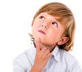 Thoughtful little boy portrait of a isolated over white Stock Photo