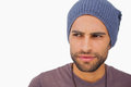 Thoughtful man wearing beanie hat on white background Royalty Free Stock Image
