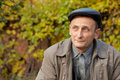Thoughtful middleaged man in autumnal garden Royalty Free Stock Photography