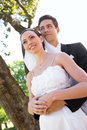 Thoughtful newly wed couple standing in garden low angle view of Royalty Free Stock Photography