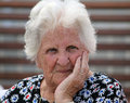 Thoughtful old woman Stock Photography