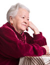 Thoughtful old woman on a white background Royalty Free Stock Images