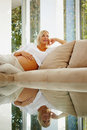Thoughtful pregnant woman relaxing on a couch Stock Photo