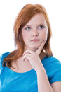 Thoughtful redheaded girl isolated on white Royalty Free Stock Photography
