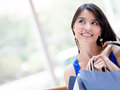 Thoughtful shopping woman Stock Images
