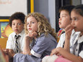 Thoughtful students sitting in classroom elementary Royalty Free Stock Image