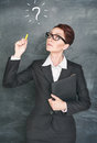 Thoughtful teacher with question sign Royalty Free Stock Photo