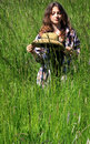 Thoughtful teen in tall grass a pretty tween girl with long brown hair standing with thoughts her head shallow depth of field copy Stock Photography