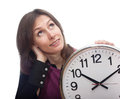 Thoughtful woman clock time isolated white Stock Photography