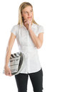 Thoughtful woman holding film slate and reel while looking away young with hand on chin against white background Royalty Free Stock Photography