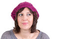 Thoughtful woman smiling in anticipation wearing a knitted purple winter cap of being able to realise her dreams looking off with Royalty Free Stock Photography
