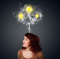Thoughtful woman with smoke and lightbulbs above her head pretty young Royalty Free Stock Photo