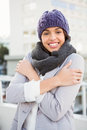 Thoughtful woman in winter coat trembling outdoor Royalty Free Stock Photography