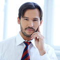 Thoughtful young businessman Royalty Free Stock Photos