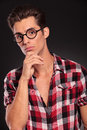 Thoughtful young man in glasses Stock Photos