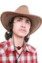 Thoughtful young man holds a cowboy hat Royalty Free Stock Photo