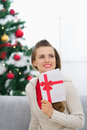 Thoughtful young woman with Christmas postcard Stock Images