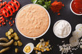 Thousand Island Dressing with ingredients close-up. horizontal t Royalty Free Stock Photo