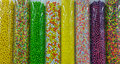 Thousands of colorful candies in plastic tubes Royalty Free Stock Photo