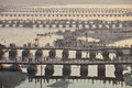 Thousands of Hindu devotees crossing the pontoon bridges over the Ganges River at Maha Kumbh Mela festival Royalty Free Stock Photo