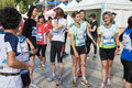Thousands of women take part in the avon running milan italy may taking gather and run through town not only for competition but Royalty Free Stock Photo