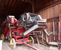 Thrashing machine colourful antique in barn Royalty Free Stock Image