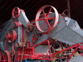 Thrashing machine colourful antique in barn Royalty Free Stock Photo