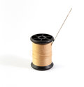Thread and needle spool of brown Stock Image
