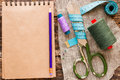 Thread, scissors, measuring tape and a notebook for notes Royalty Free Stock Photo