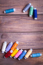 Thread and sewing on wooden boards Stock Images