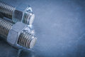 Threaded bolt details and screw nuts on metallic surface constru construction concept Stock Images
