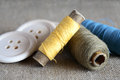 Threads and buttons sewing concept closeup of spools of thread near wooden Royalty Free Stock Photography