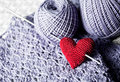 Threads with red handmade knitted  heart Royalty Free Stock Photo