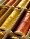 Threads spools of colorful in a box Stock Photos