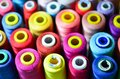 Threads in spools tape measure, needle bar, needle and scissors Royalty Free Stock Photo