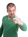 Threatening gesture tough guy making wit his finger Stock Photos