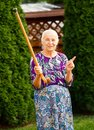 Threatening grandma funny grandmother with her walking stick Royalty Free Stock Photos