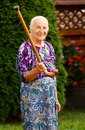 Threatening granny funny grandmother with her walking stick Stock Images