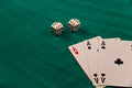 three aces and two dices on green background casino games fortune luck Royalty Free Stock Photo