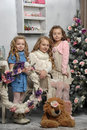 Three adorable little girls waiting for christmas Royalty Free Stock Image
